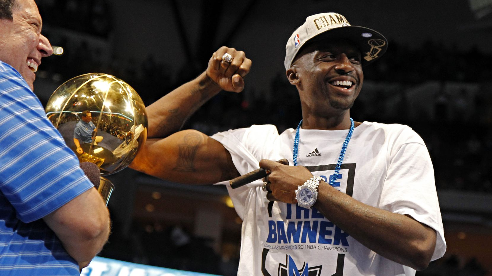 Jason Terry (right) flashes his championship trophy tattoo next to the real deal as Chuck Cooperstein looks on during the 2011 Dallas Mavericks NBA World Championship Celebration Thursday, June 16, 2011 in Dallas. (G.J. McCarthy/The Dallas Morning News) 12122012xSPORTS