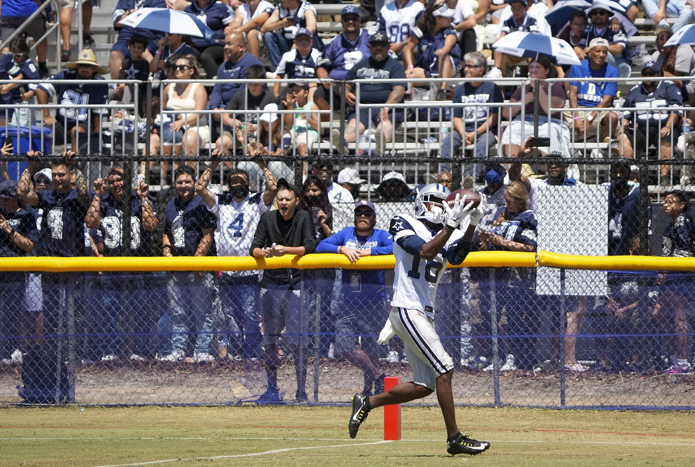 Dallas Cowboys fans watch wide receiver Reggie Davis haul in a pass during a practice at training camp on Sunday, Aug. 1, 2021, in Oxnard, Calif.