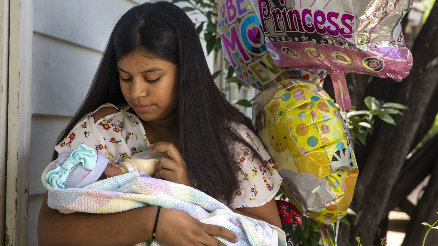 "Jocelyne Tapia holds her 8-day-old newborn, Jalees, during a portrait session at her home in West Oak Cliff in Dallas on Wednesday, May 6, 2020. Tapia gave birth to Jalees in the middle of the COVID-19 pandemic. ""I was scared, and I didn't know what was going to happen,"" Tapia said, but added that having a baby in the midst of the pandemic has an upside. ""Even though our lives are scary, [Jalees] brought joy into our lives."" (Lynda M. Gonzalez/The Dallas Morning News)"