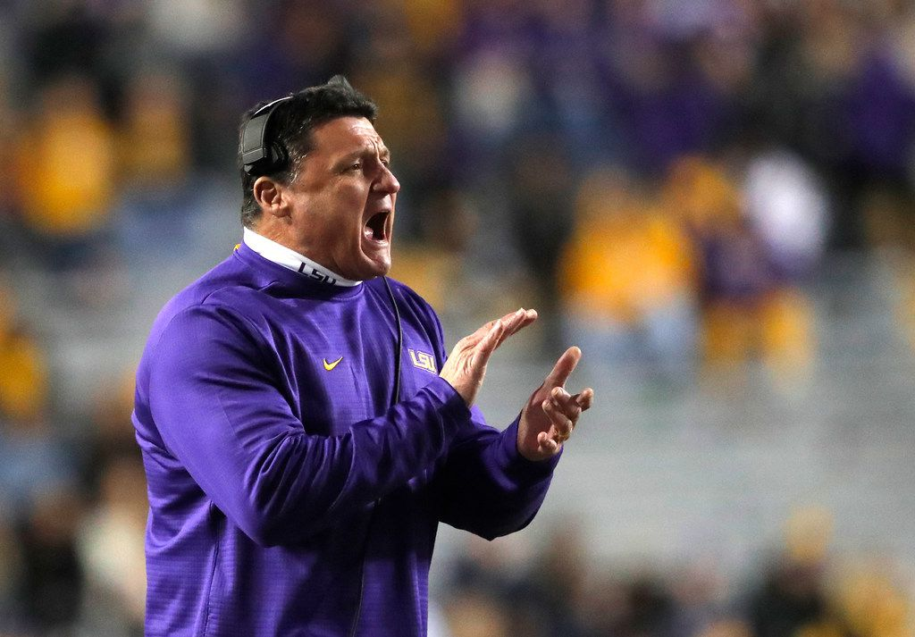 LSU head coach Ed Orgeron calls out from the sideline in the second half of an NCAA college football game against Rice in Baton Rouge, La., Saturday, Nov. 17, 2018. (AP Photo/Gerald Herbert)