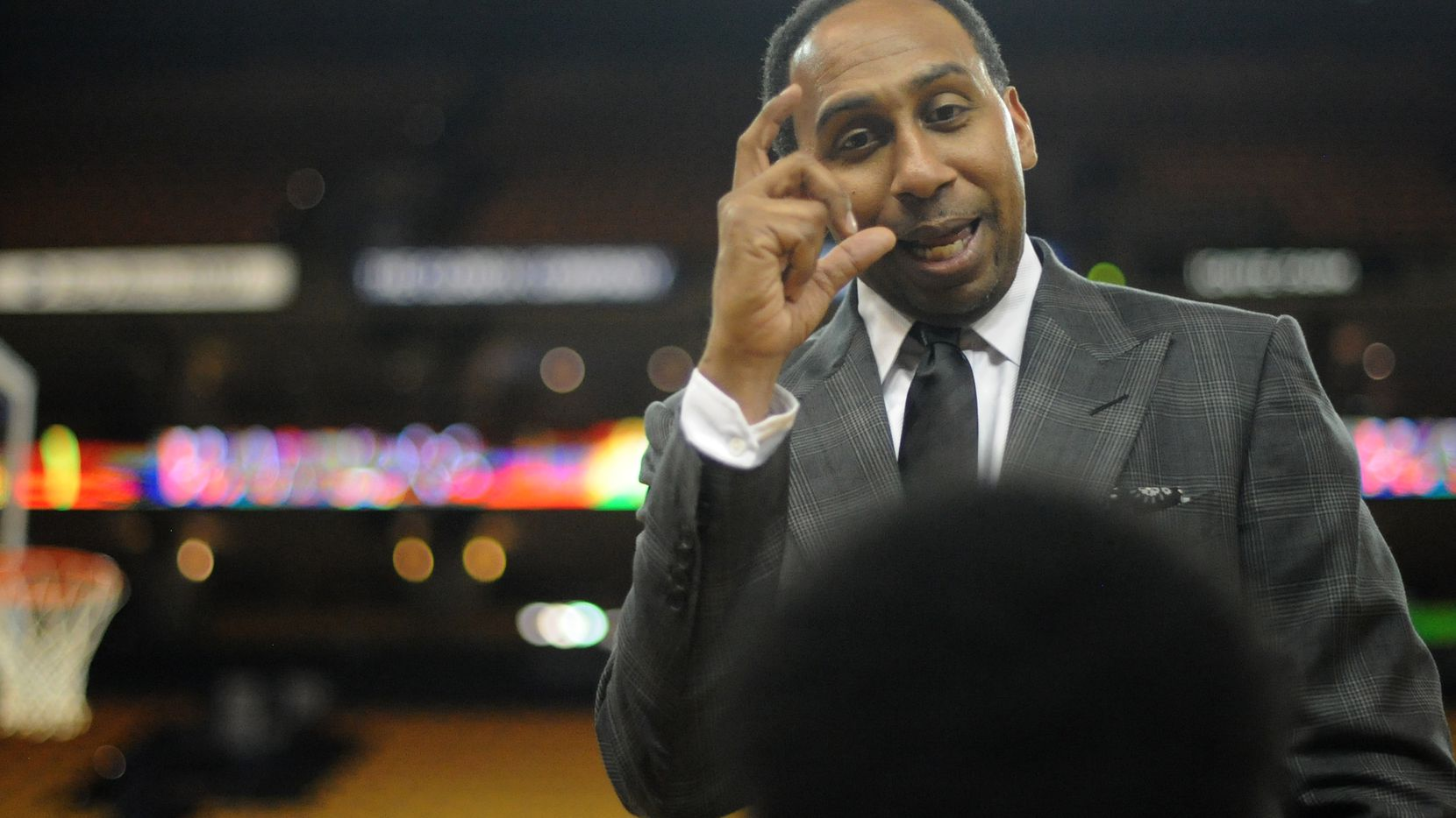 TV sports personality Stephen A. Smith speaks with youth from the Hidden Genius Project prior to Game Seven of the Western Conference Finals between the Golden State Warriors and the Oklahoma City Thunder during the 2016 NBA Playoffs at ORACLE Arena on May 30, 2016 in Oakland, California.