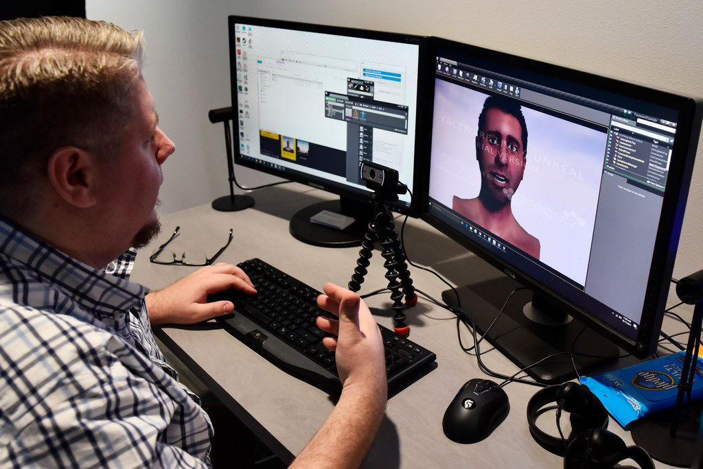 Aaron Tate, lead artist for the Brain Performance Institute, uses a camera and software to scan real-time facial expressions for a virtual world.