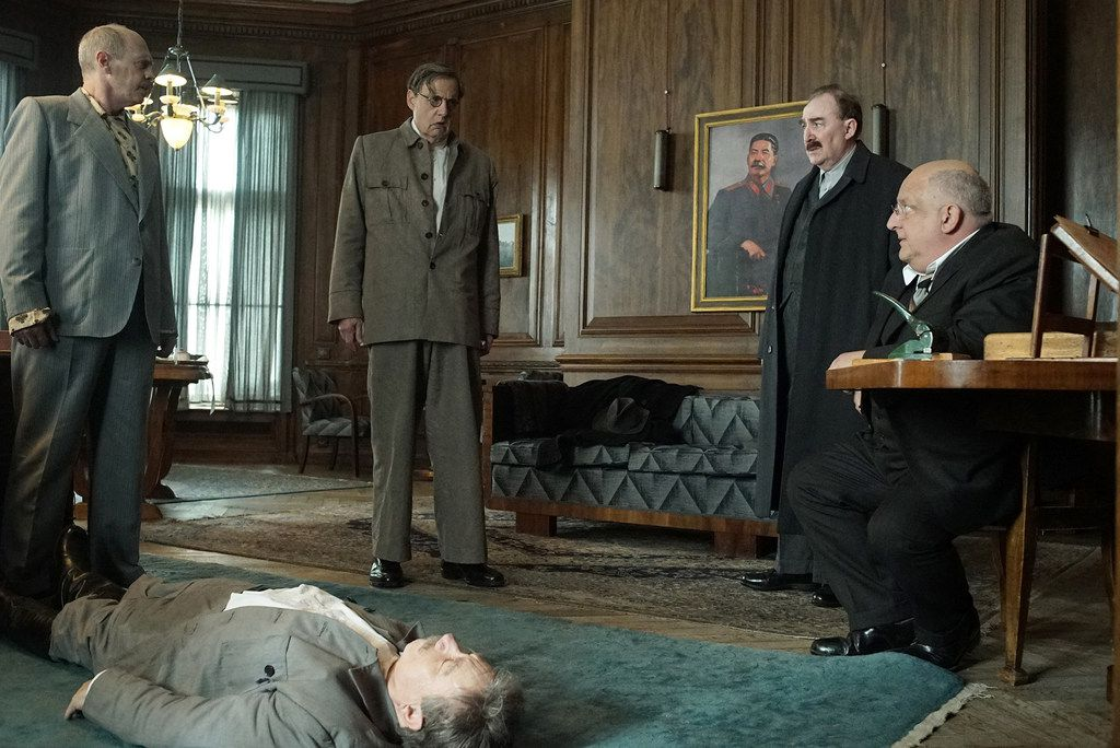 "Gathered around the body of Joseph Stalin (played by Adrian McLoughlin) are, from left, Steve Buscemi as Nikita Khrushchev, Jeffrey Tambor as Georgy Malenkov, Dermot Crowley as Lazar Kaganovich and Simon Russell Beale as Lavrenti Beria in Armando Iannucci's ""The Death of Stalin."""