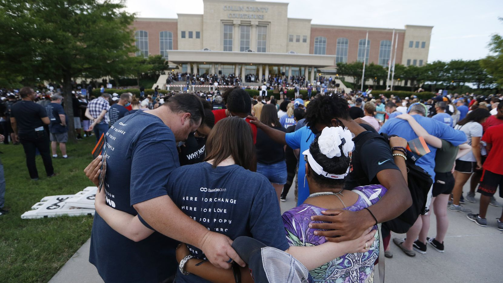 People prayed Sunday at Collin County Courthouse in McKinney as part of an event organized by local churches to spread a message of unity, justice and anti-racism.