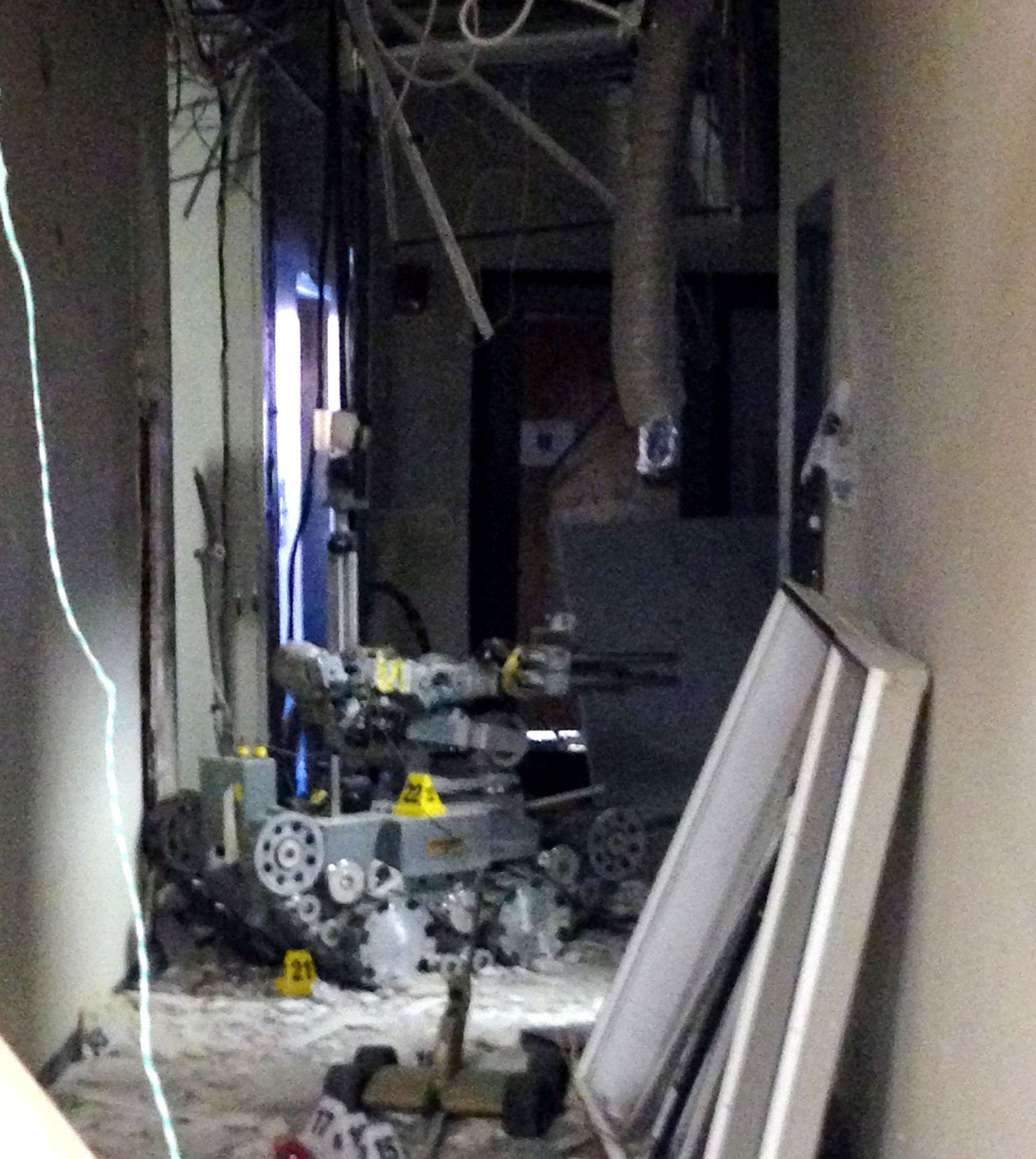 This is the remote-controlled robot that two officers used to detonate a brick of C-4 explosive that killed gunman Micah Johnson. The photo is of the scene inside the hallway at El Centro College, taken the morning after the July 7 shootings.