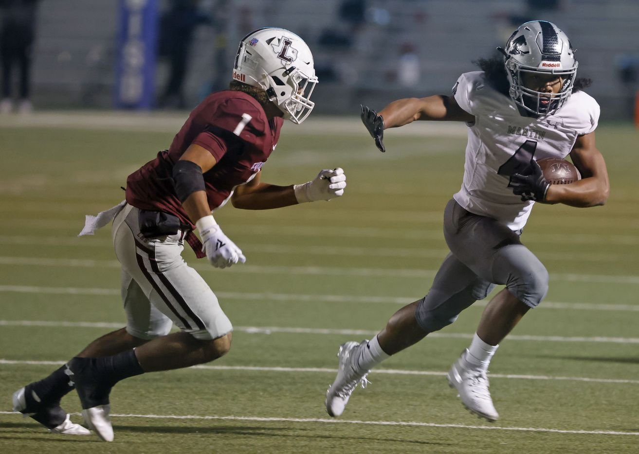 Arlington Martin running back Zaire Barrow (4) runs past Lewisville defender Jaydan Hardy (1) during Class 6A Division I area-round playoff hight school football game on Dec. 17, 2020. (Michael Ainsworth/Special Contributor)