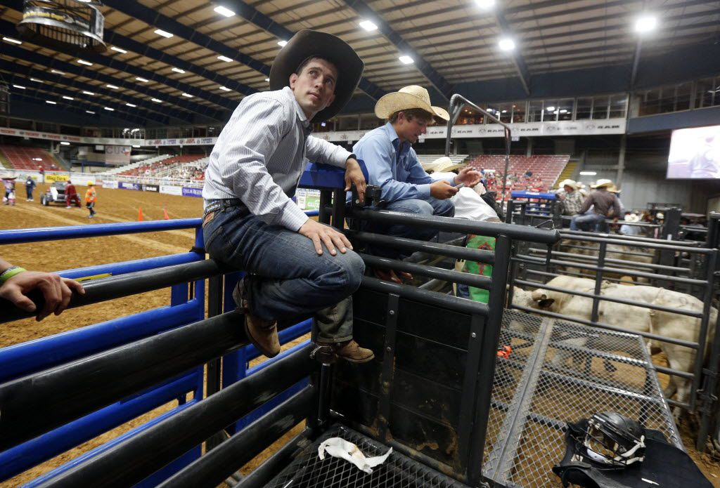 Bull rider McKennon Wimberly, left, waits for competition at the Mesquite Rodeo on June 6, 2014. (Michael Ainsworth/The Dallas Morning News)