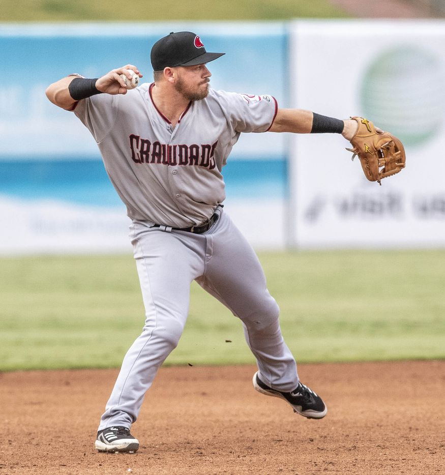 Hickory Crawdad's third baseman Trey Hair (6) throws to first base during the game with the Greensboro Grasshopper's at First National Bank Field on Friday, August 6, 2021 in Greensboro, N.C. (Woody Marshall/Special Contributor)