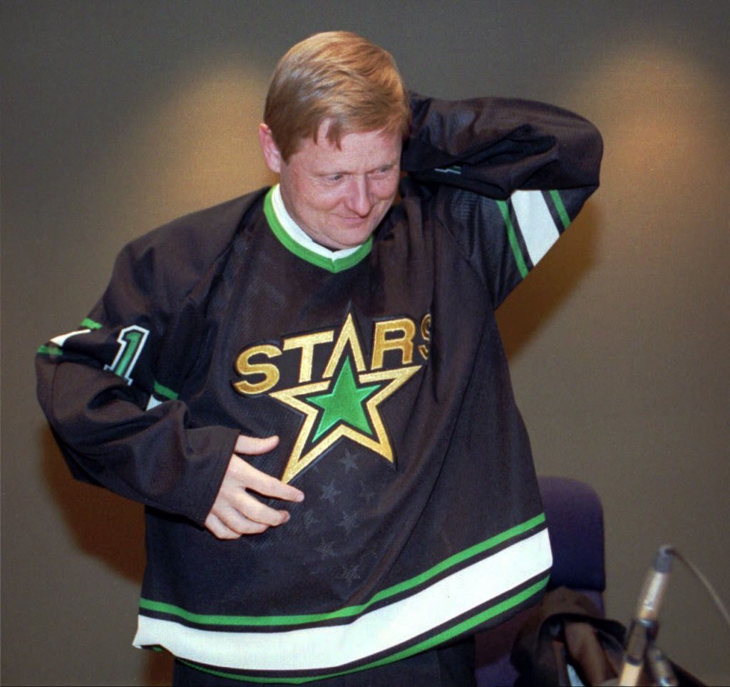 March 11, 1993 --Dallas Mayor Steve Bartlett dons a Dallas North Stars jersey in the city council chambers in Dalla. The North Stars have announced they will move from Minnesota to Dallas. (AP Photo)