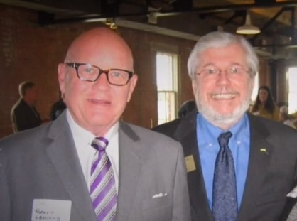 Robert Leonard (left), CEO of Force Multiplier Solutions, and Larry Duncan, former president of the board of trustees for the Dallas County Schools bus agency, are shown at a social gathering.