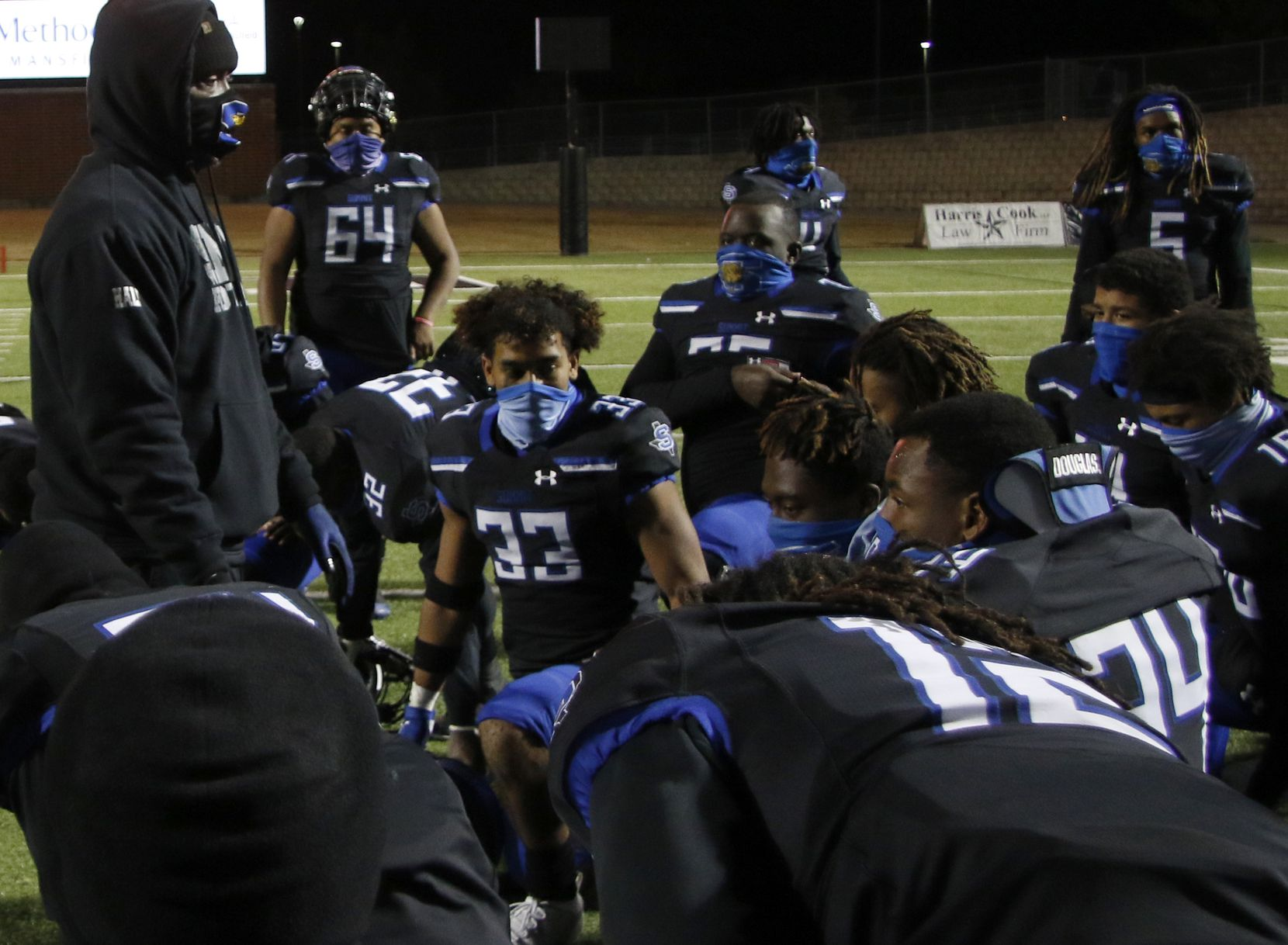 Mansfield Summit head coach Channon Hall speaks with his team following their 38-24 victory over Birdville to earn a playoff berth. The two teams played their District 4-5A Division l football game at Vernon Newsom Stadium in Mansfield on December 3, 2020.
