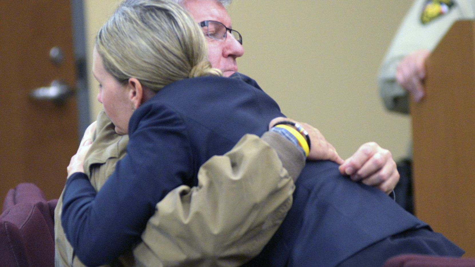 Bernie Tiede hugged attorney Jodi Coles at his April hearing. (Kevin Green/Longview News-Journal)
