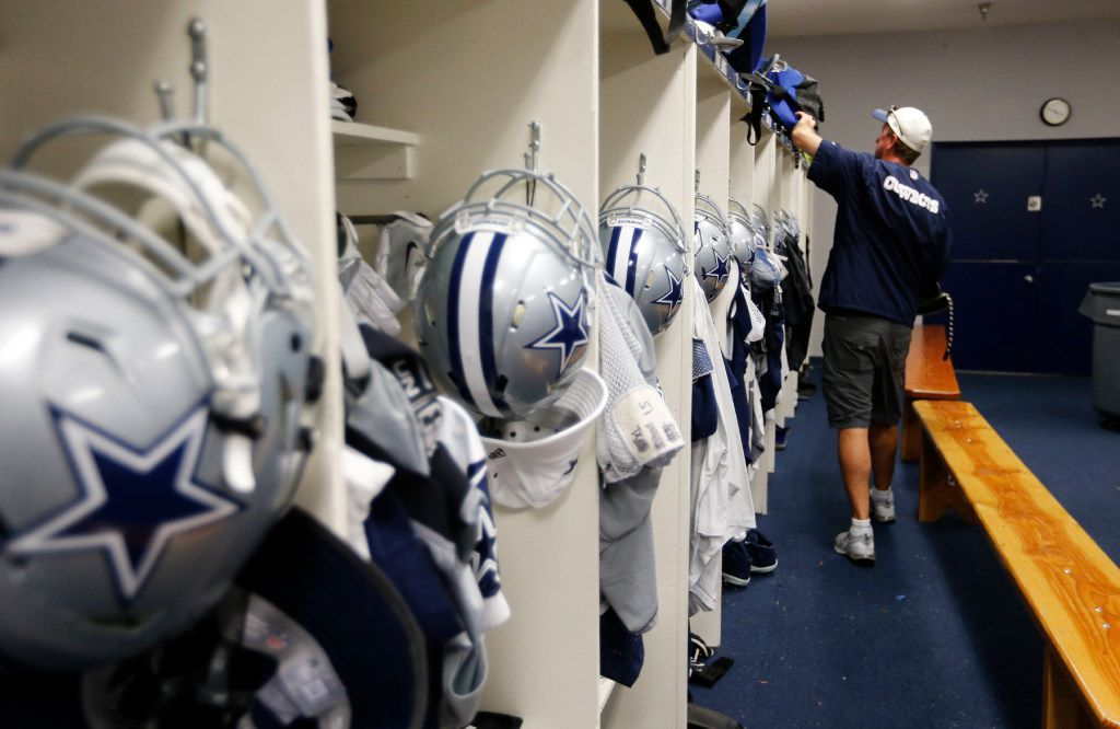 Dallas Cowboys equipment director Mike McCord checks on game bags in the locker room after practice during training camp in Oxnard, California on Thursday, August 10, 2017.