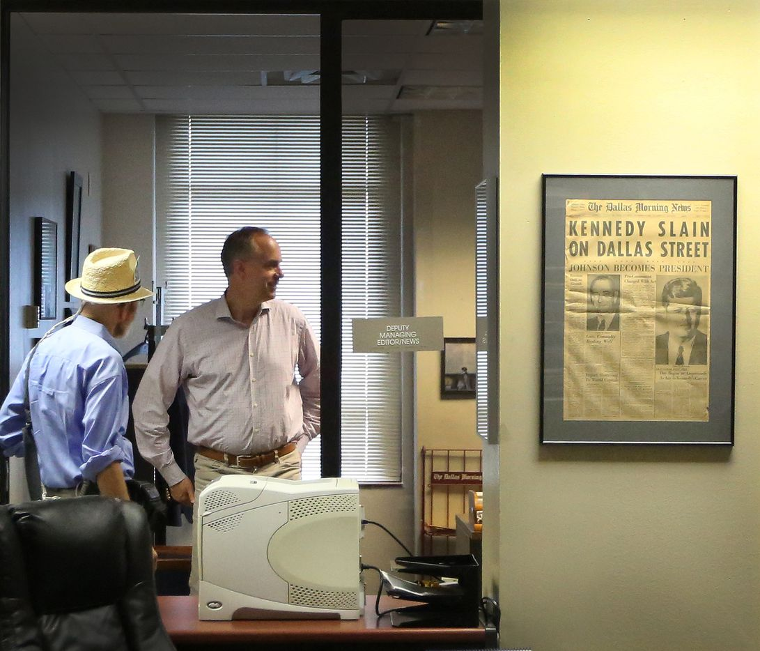 Weiss visits with Keith Campbell, deputy managing editor for news and business, in Campbell's office.