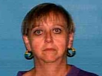 Marylyn Evans is described as a white woman who is 5 feet tall and about 100 pounds, with gray hair and blue eyes.