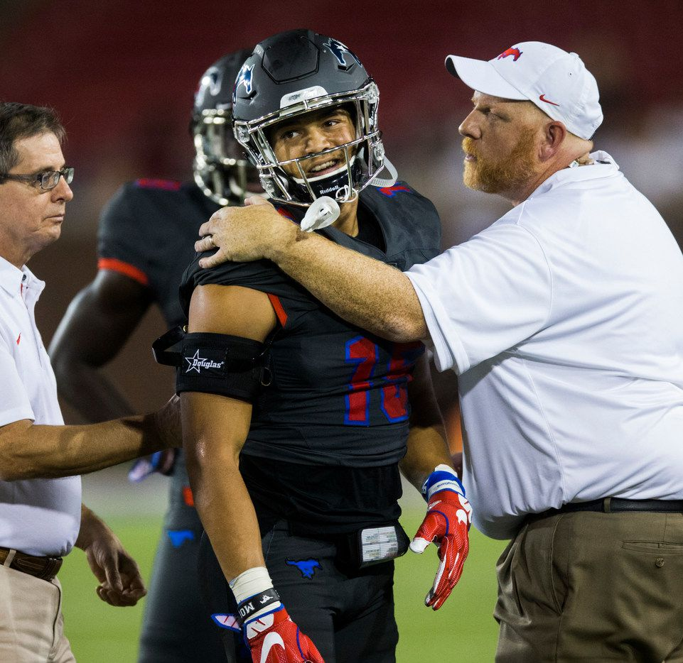 Southern Methodist Mustangs defensive back Jordan Wyatt (15) smiles as he's checked out on the field for possible injury during the third quarter of a game between Arkansas State and SMU on Saturday, September 23, 2017 at Ford Stadium on the SMU campus in Dallas. (Ashley Landis/The Dallas Morning News)