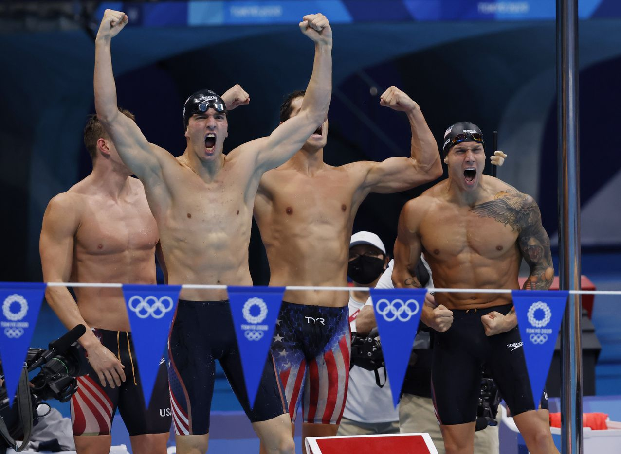 (Left to right) USA's Ryan Murphy, Zach Apple, Michael Andrew and Caeleb Dressel celebrate setting a new world record in the men's 4x100 meter medley relay final during the postponed 2020 Tokyo Olympics at Tokyo Aquatics Centre, on Sunday, August 1, 2021, in Tokyo, Japan. USA earned a gold medal, setting a new world record with a time of 3:26.78. (Vernon Bryant/The Dallas Morning News)
