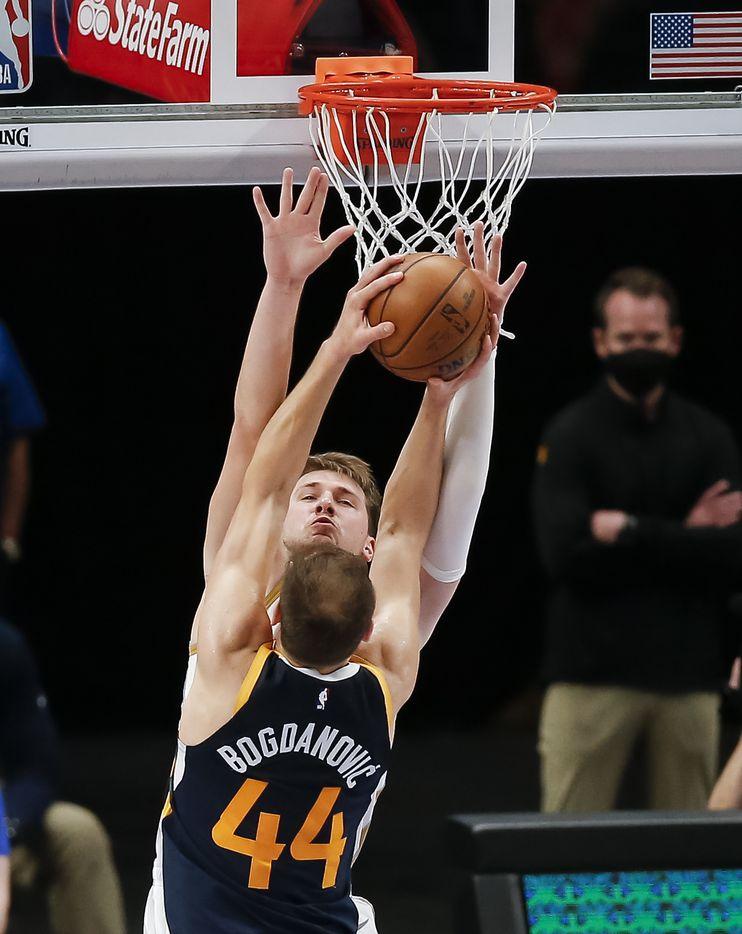 Utah Jazz forward Bojan Bogdanovic (44) attempts a shot as Dallas Mavericks guard Luka Doncic (77) defendsduring the second half of an NBA basketball game in Dallas, Monday, April 5, 2021. Dallas won 111-103. (Brandon Wade/Special Contributor)
