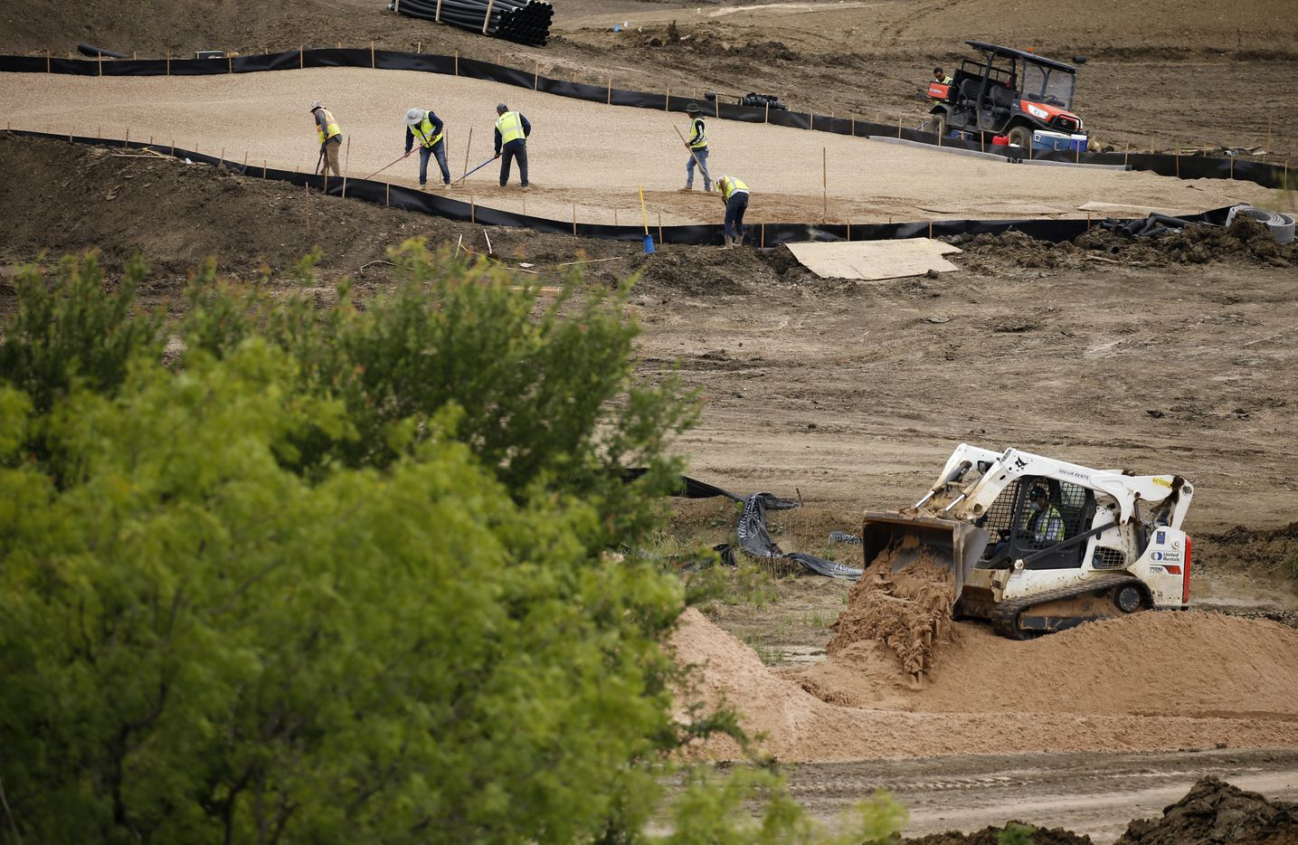 Construction continues on the green of hole 3 on the West Course designed by Beau Welling at PGA Frisco in Frisco, Texas, on Wednesday, May 20, 2020. The $520 million project is a mixed-use development that will be home to the PGA of America headquarters and two championship golf courses.