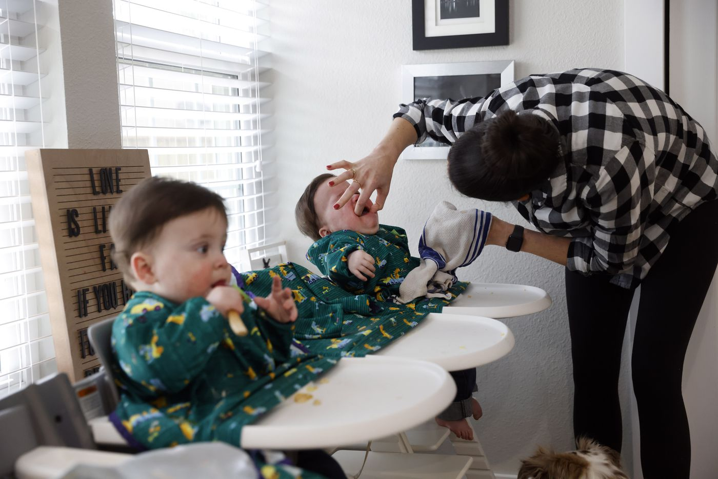 Jenny Marr checks for food in the mouth of Hudson Marr as Hardy works on eating a spoonful of banana pudding during lunch at their house on Tuesday, February 9, 2021 in Grapevine, Texas.