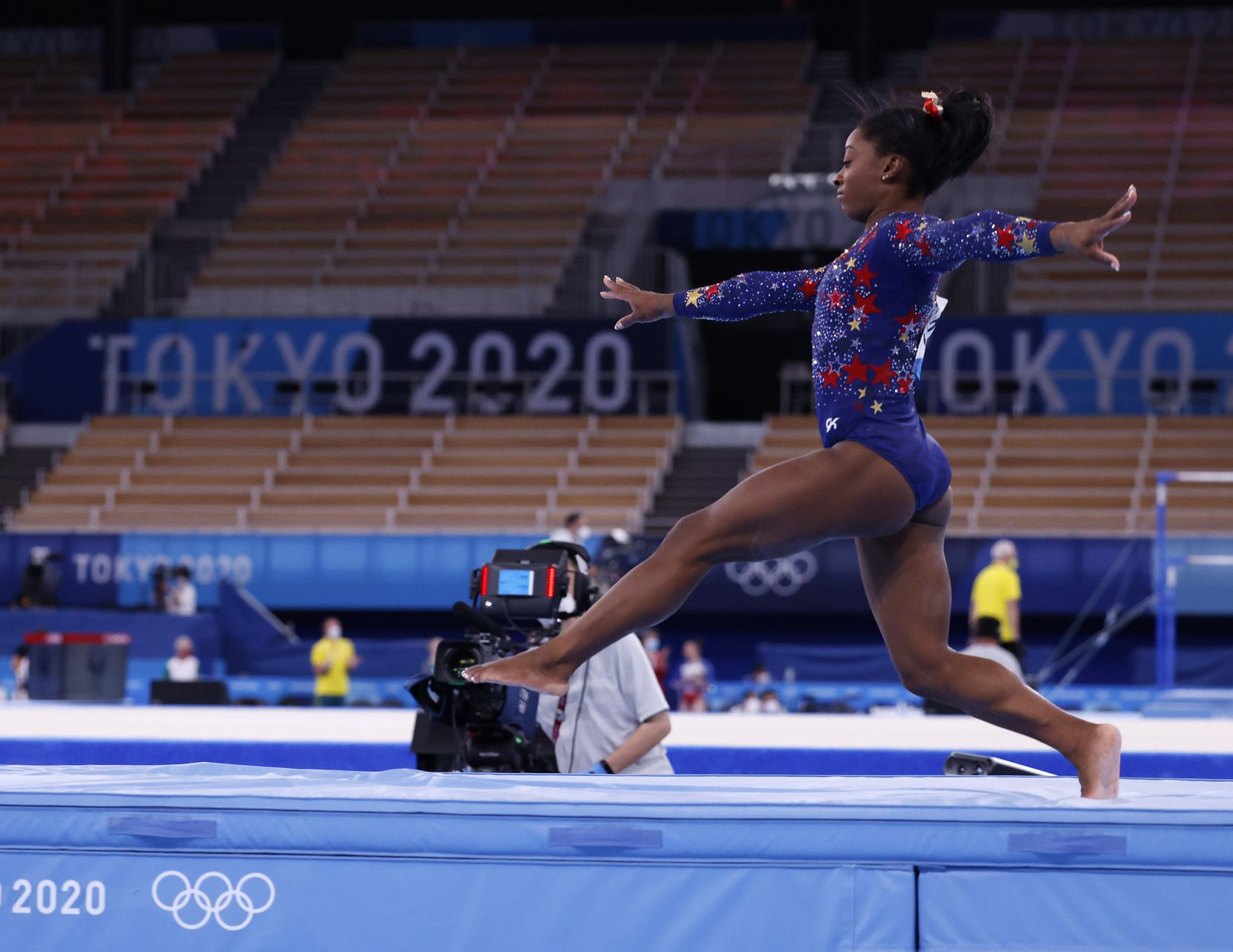 USA's Simone Biles takes a few steps upon landing while competing on the balance beam in a women's gymnastics event during the postponed 2020 Tokyo Olympics at Ariake  Gymnastics Centre on Sunday, July 25, 2021, in Tokyo, Japan. (Vernon Bryant/The Dallas Morning News)