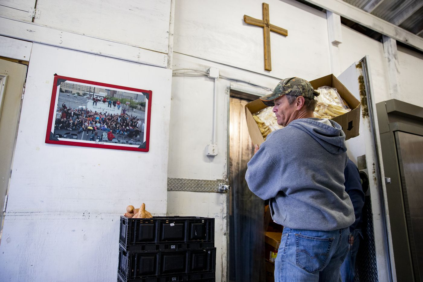 A volunteer with Victory Life Ministry helped distribute food to local faith leaders from Jennifer and Leon Birdd's food pantry in their Mesquite backyard on Dec. 20, 2019. Faith leaders used the donated food to help feed their communities.
