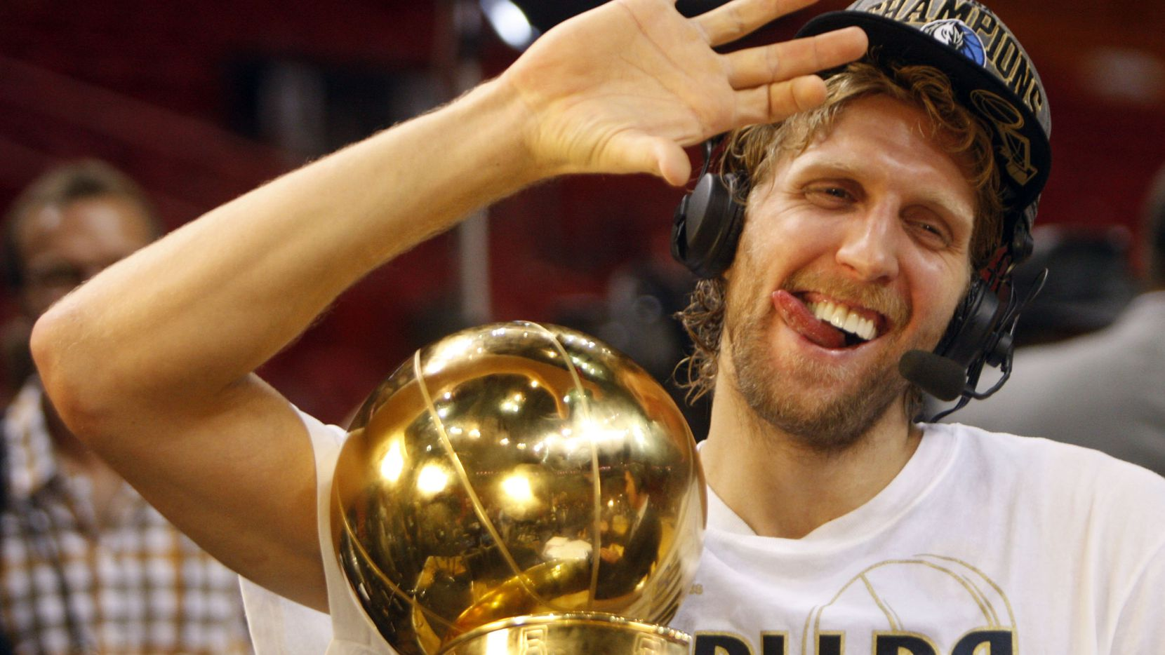 Dallas Mavericks power forward Dirk Nowitzki (41) shows how he drinks his champagne with his right hand after he was asked if he had any problems holding the bottle in celebration after winning in game six of the NBA Finals between the Miami Heat and the Dallas Mavericks at the American Airlines Arena in Miami, Florida, June 12, 2011.