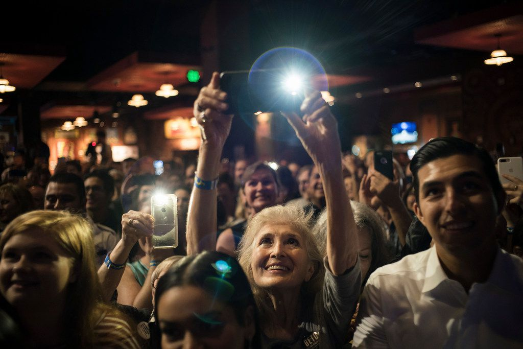 A woman takes a photograph during an event for Rep. Beto O'Rourke (D-Texas), the Democratic challenger to Sen. Ted Cruz (R-Texas), at the House of Blues in Houston, Nov. 5, 2018. (Todd Heisler/The New York Times)