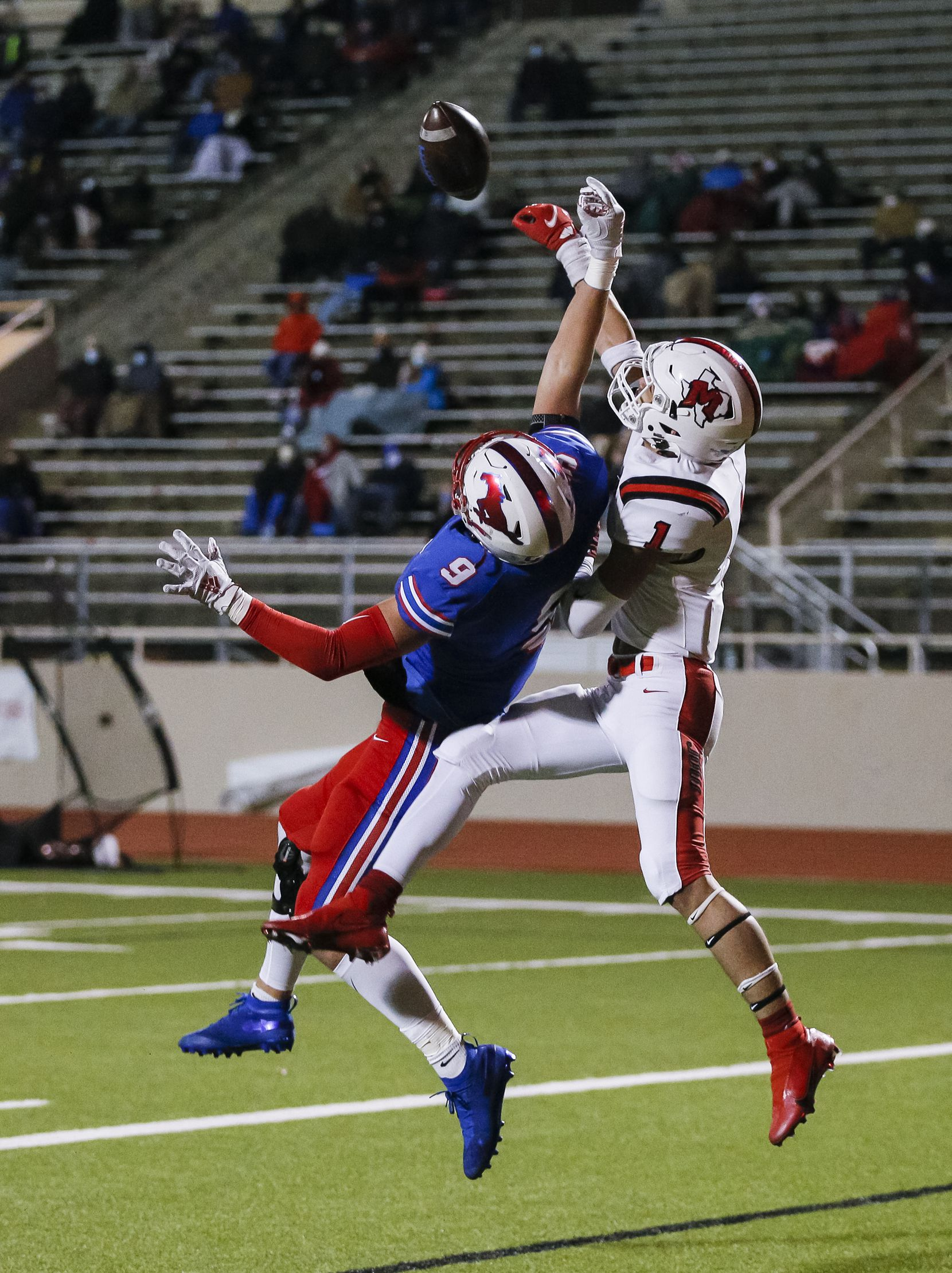 Irving MacArthur senior Roland Jackson (1) breaks up a pass intended for JJ Pearce senior halfback Dylan Adams (9) in the end zone during the first half of a high school playoff football game at Eagle-Mustang Stadium in Richardson, Thursday, December 3, 2020. (Brandon Wade/Special Contributor)