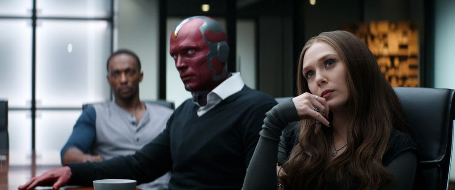 """In this image released by Disney, Anthony Mackie, from left,  Paul Bettany and Elizabeth Olsen appear in a scene from """"Captain America: Civil War."""""""