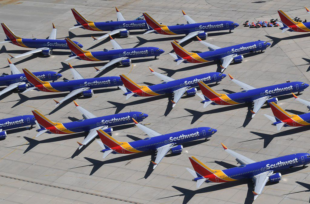 In this photo taken on March 28, 2019, Southwest Airlines Boeing 737 MAX aircraft are parked on the tarmac after being grounded at the Southern California Logistics Airport in Victorville, Calif.
