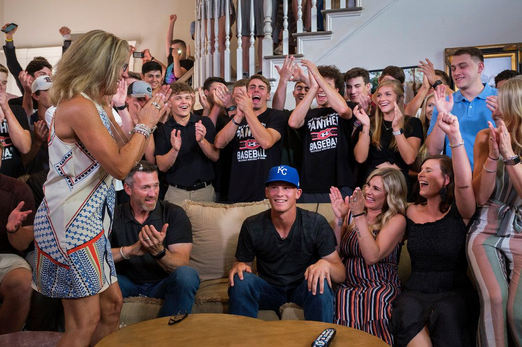 Bobby Witt Jr. (center) celebrates with (from left) his mother Laurie Witt, father Bobby Witt, and sisters Shaley Witt, Nicole Russell and Kianna Neal,along with a crowd of teammates friends and family, during a Major League Baseball draft night watch party at his home on Monday, June 3, 2019, in Colleyville, Texas. Witt, a Colleyville Heritage player whose father is a former Texas Rangers pitcher, was selected second by the Kansas City Royals. (Smiley N. Pool/The Dallas Morning News