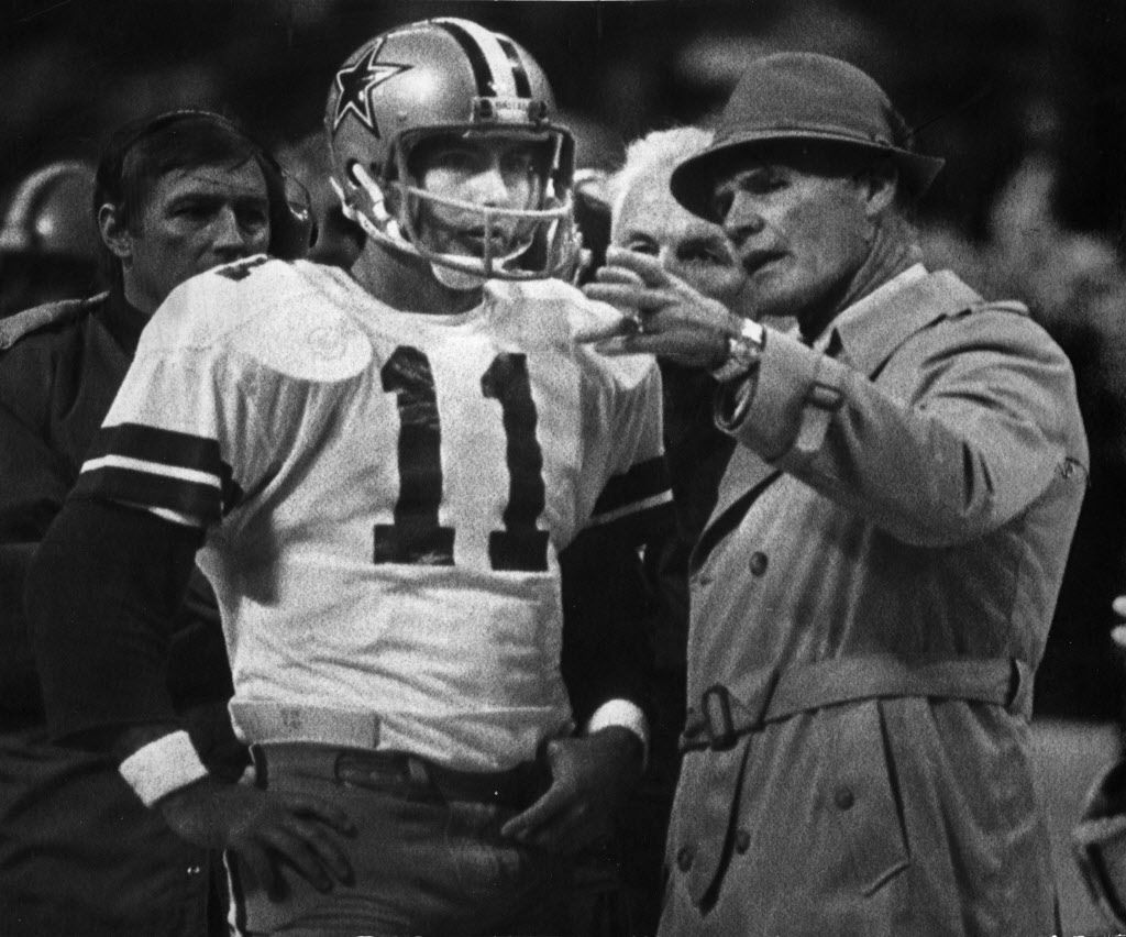 Dallas Cowboys coach Tom Landry gives instructions to quarterback Danny White (11) during the Philadelphia Dallas game in December in Texas Stadium. White is averaging 7.92 yards per pass and has thrown 22 touchdown passes.