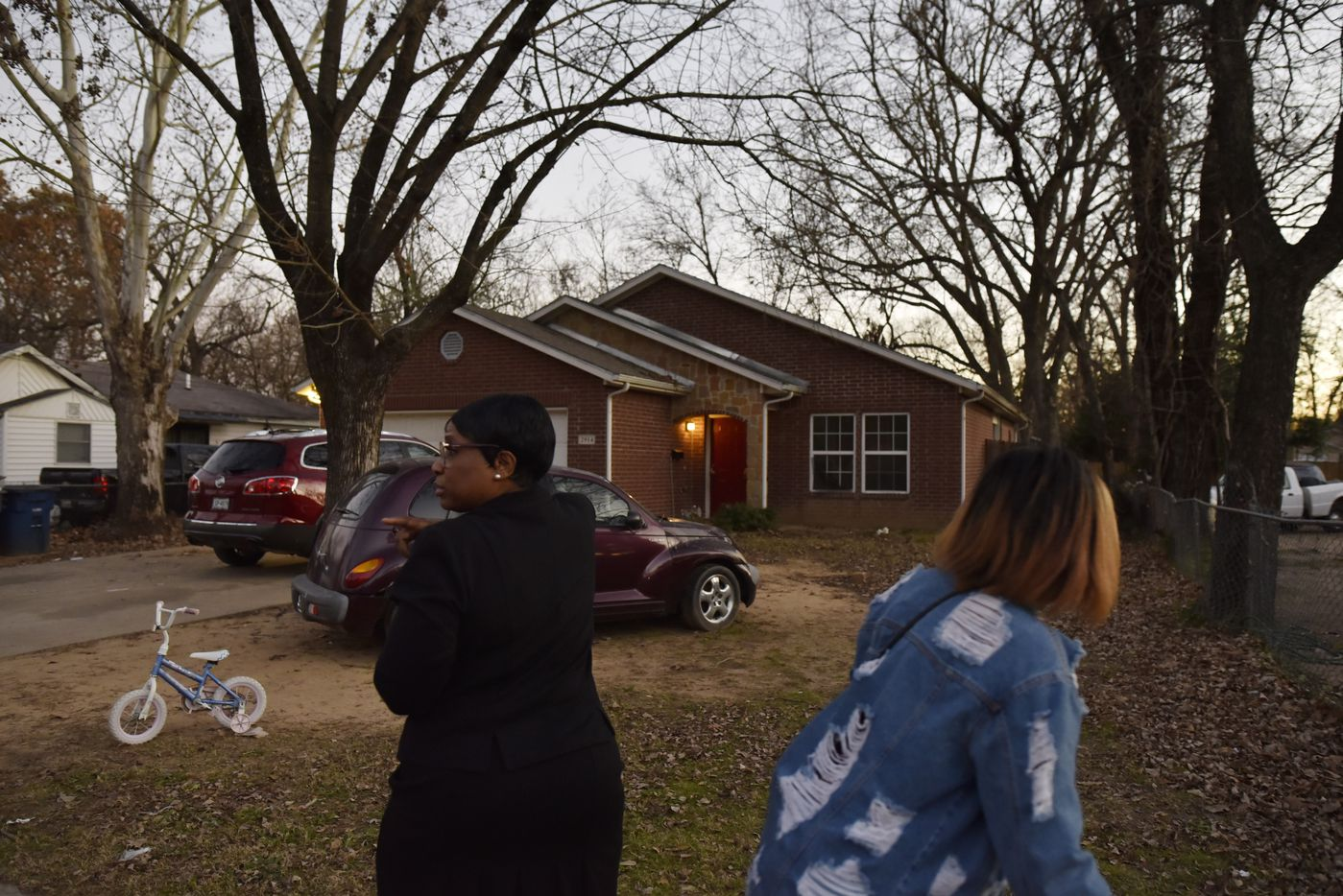 Ella Mae Beasley, 57, left, and her niece   walked by the home where Rory Norman and his uncle were shot inside their home on Valentine Street. Beasley, who has lived in the neighborhood all her life, was sad about the death of the boy.