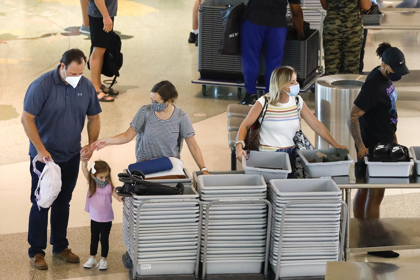 Travelers load their belongings into containers at a security checkpoint at Dallas Love Field. That's one of the changes resulting from the 2001 terrorist attacks.