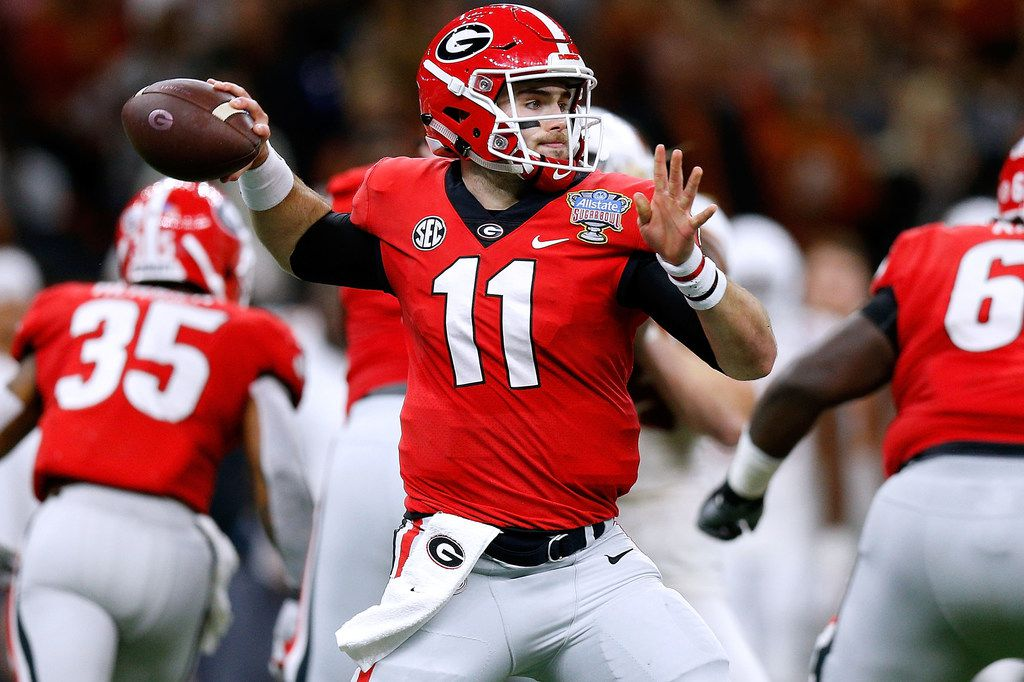 NEW ORLEANS, LOUISIANA - JANUARY 01: Jake Fromm #11 of the Georgia Bulldogs throws the ball during the first half of the Allstate Sugar Bowl against the Texas Longhorns at the Mercedes-Benz Superdome on January 01, 2019 in New Orleans, Louisiana. (Photo by Jonathan Bachman/Getty Images)