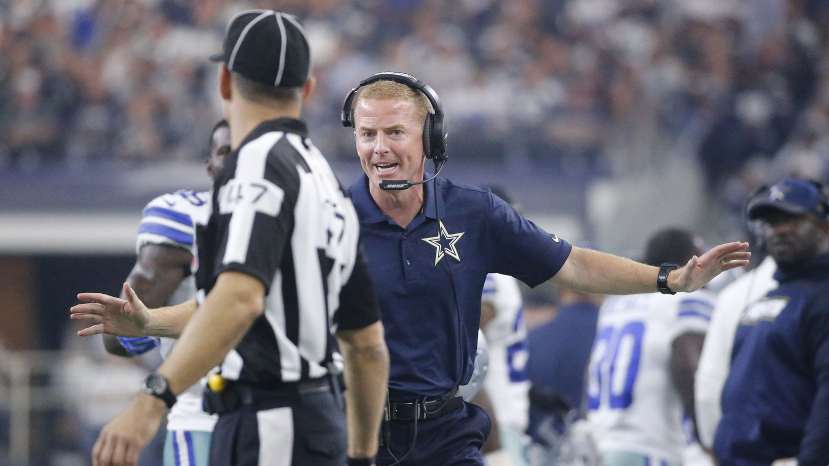 Dallas head coach Jason Garrett talks with an official at the end of the second quarter during the Seattle Seahawks vs. the Dallas Cowboys NFL football game at AT&T Stadium in Arlington on Sunday, November 1, 2015. (Louis DeLuca/The Dallas Morning News)