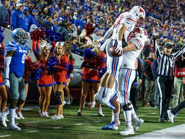 SMU tight end Kylen Granson (83) celebrates with offensive lineman Beau Morris (78) after scoring on a 16-yard touchdown reception past Memphis defensive back John Broussard Jr. (9) during the first half of an NCAA football game at Liberty Bowl Memorial Stadium on Saturday, Nov. 2, 2019, in Memphis, Tenn. (Smiley N. Pool/The Dallas Morning News)