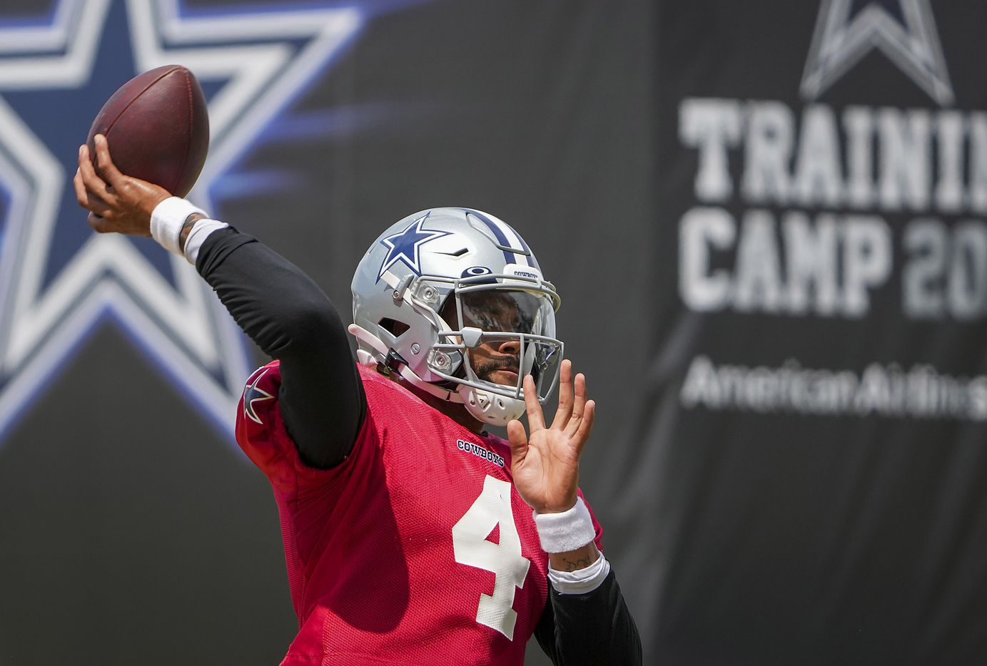 Dallas Cowboys quarterback Dak Prescott throws a pass in a drill during a practice at training camp on Wednesday, Aug. 11, 2021, in Oxnard, Calif.