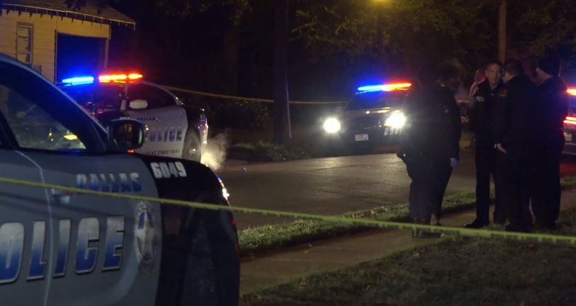 Dallas police investigate the scene of a fatal drive-by shooting Thursday night in South Dallas.