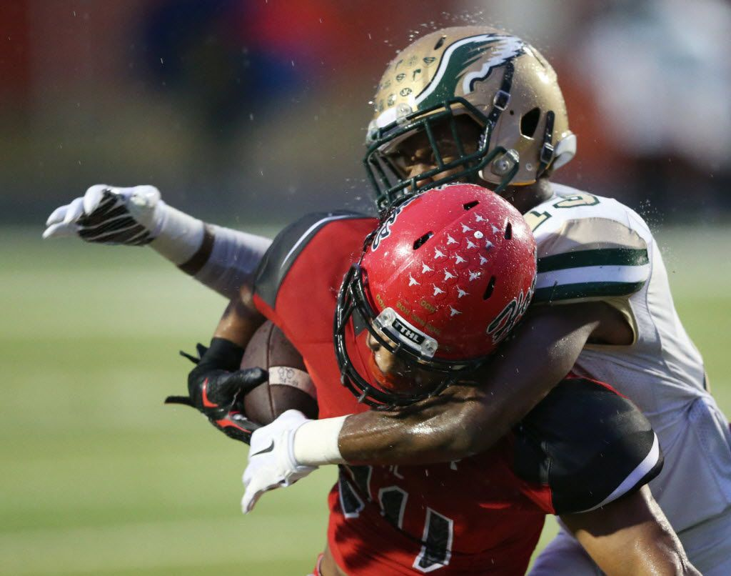 Cedar Hill's Kaegun Williams (24) is tackled by DeSoto's Isaiah Stewart (13) during the first half of play at Longhorn Stadium in  Cedar Hill, on Friday, October 23, 2015. (Vernon Bryant/The Dallas Morning News)