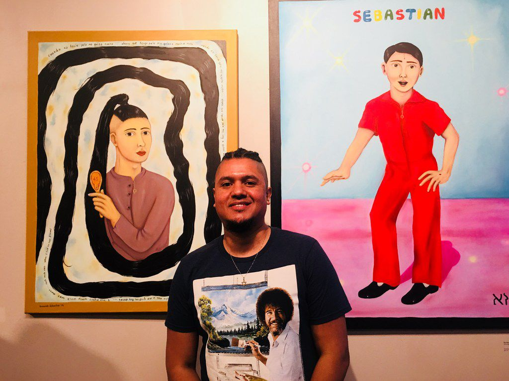 The artist Armando Sebastian poses with his paintings during the art show MaricónX featuring Hispanic LGBT artists at the Oak Cliff Cultural Center on May 4.