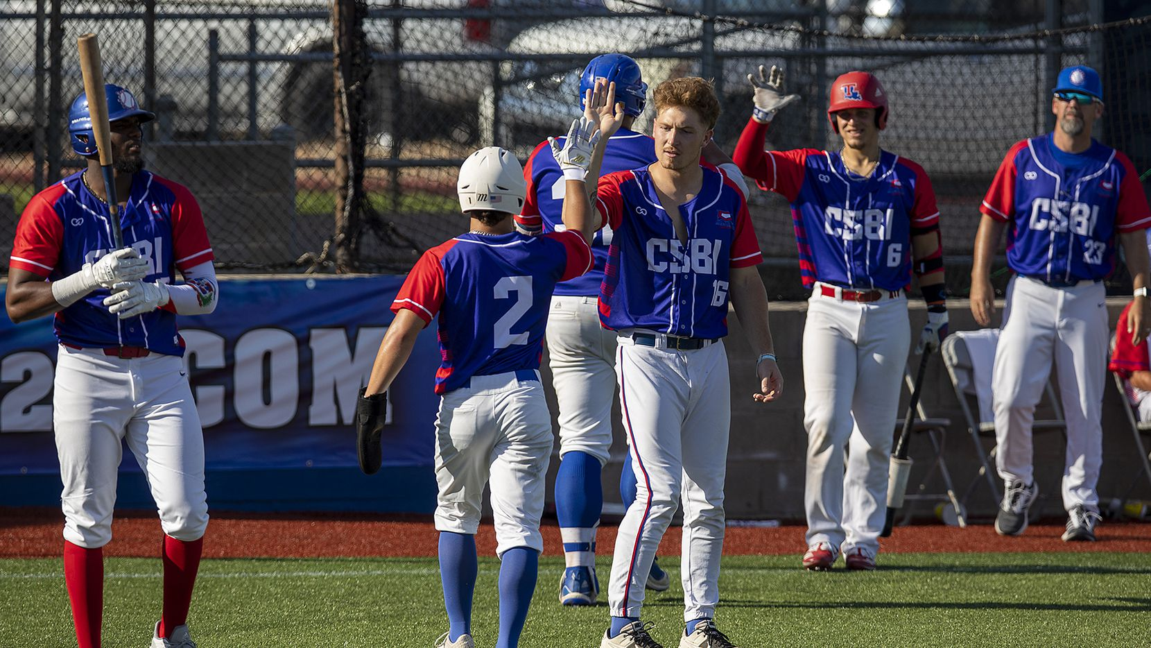 Independence's Nolan Tucker (2) (Valparaiso) celebrates with teammate Buddy Dewaine (16) (Central Connecticut State) after scoring a run during game action of the College Summer Baseball Invitational tournament against Unity at Travis Field in Bryan, Texas, Friday, June 5, 2020.