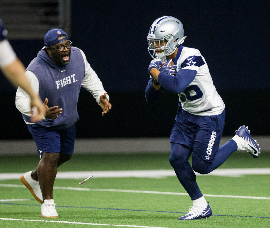 Dallas Cowboys running back Tony Pollard (36) gets some encouragement from running backs coach Gary Brown during a Dallas Cowboys OTA practice on Wednesday, May 29, 2019 at The Star in Frisco. (Ashley Landis/The Dallas Morning News)