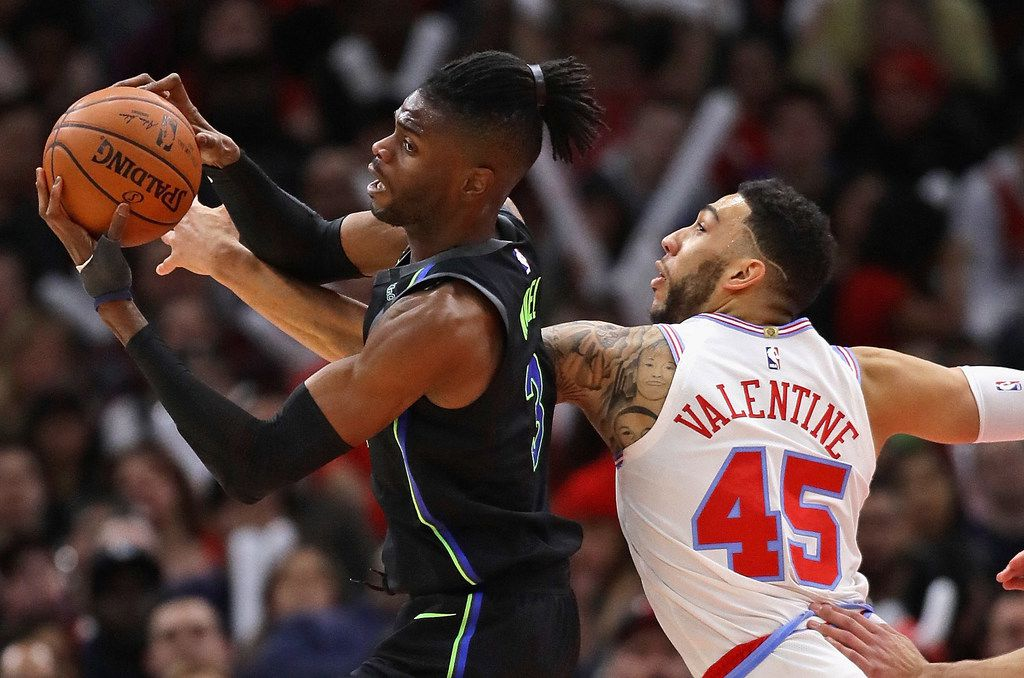 CHICAGO, IL - MARCH 02:  Nerlens Noel #3 of the Dallas Mavericks rebounds against Denzel Valentine #45 of the Chicago Bulls at the United Center on March 2, 2018 in Chicago, Illinois. The Bulls defeated the Mavericks 108-100. NOTE TO USER: User expressly acknowledges and agrees that, by downloading and or using this photograph, User is consenting to the terms and conditions of the Getty Images License Agreement. (Photo by Jonathan Daniel/Getty Images)