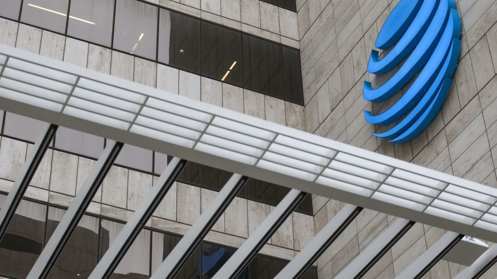 "Dallas-based AT&T said ""targeted, but sizable reductions"" will include executives, managers and union employees."