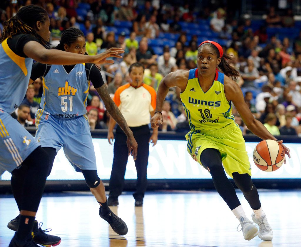 Dallas Wings guard Kaela Davis (10) drives towards the basket as Chicago Sky forward Amber Harris (11) looks to defend during the second half of play at College Park Center in Arlington on Sunday, July 16, 2017. Dallas Wings defeated the Chicago Sky 112-106 in double overtime.