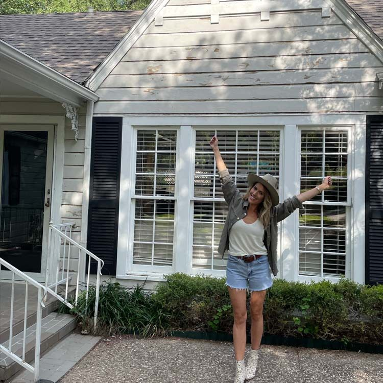 Brittany Cobb, founder of Flea Style, stands in front of the Bungalow in Fort Worth that the Dallas-based company is renovating to turn into a vacation rental.