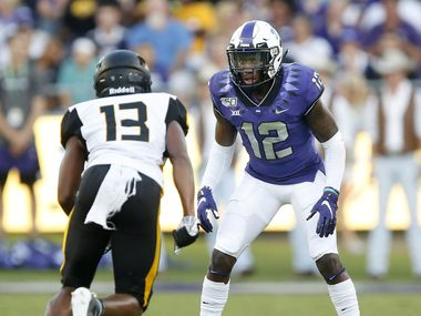 TCU Horned Frogs cornerback Jeff Gladney (12) squares up against Arkansas-Pine Bluff Golden Lions wide receiver DeJuan Miller (13) during the  first quarter at Amon G. Carter Stadium in Fort Worth Texas, Saturday, August 31, 2019. (Tom Fox/The Dallas Morning News)