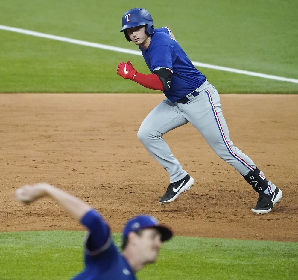 Texas Rangers infielderJustin Foscue takes off from first base as pitcher Jason Bahr delivers during a game between players at the team's alternate training site at Globe Life Field on Saturday, Sept. 19, 2020.